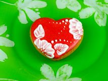 Cookie heart on green background royalty free stock image