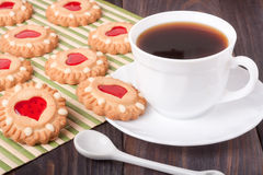 Cookie with heart  jelly and cup of coffee bamboo napkin Stock Photo