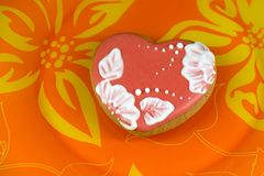 Cookie heart on orange background royalty free stock photos