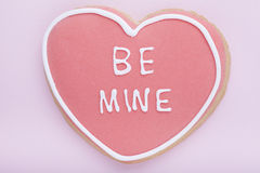 Cookie, Heart shaped biscuit with frosting words  be mine Stock Photography