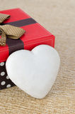 Cookie with icing in the form of heart near the gift box, select Royalty Free Stock Images