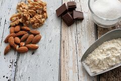 Cookie ingredients almonds, walnuts, chocolate, sugar and flour Royalty Free Stock Photo