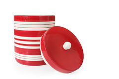 Cookie Jar. Cheerful red and white striped cookie jar, with lid off.  Isolated on white.  Clipping path included Royalty Free Stock Photos