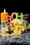 Cookie letters with cookie dough and a candle, german text in fr Royalty Free Stock Images