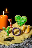 Cookie letters with cookie dough and a candle, text i love you  Royalty Free Stock Photography