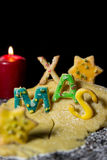 Cookie letters with cookie dough and a candle, word xmas with st Stock Image