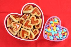 Cookie and love candies. Heart shape cookie and love candies in bowl stock photos