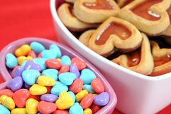 Cookie and love candies. Heart shape cookie and love candies in bowl royalty free stock photo