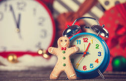 Cookie man and alarm clock Stock Photography