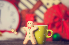 Cookie man and cup Royalty Free Stock Photography