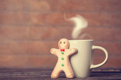 Cookie man and cup Stock Photography