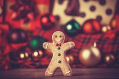 Cookie man and gifts. Royalty Free Stock Images