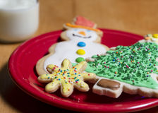 Cookie and milk for Santa. A plate of decorated sugar cookies and glass of milk for Santa Stock Image