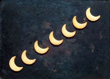 Cookie in moon shape on vintage rusty metal background. Ramadan festival background. stock photography