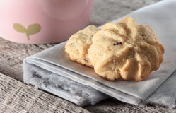 Cookie with napkin on wooden table. Royalty Free Stock Photography