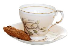 Cookie with old tea cup and saucer Royalty Free Stock Photo