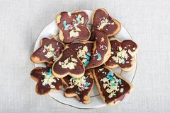 Cookie on plate. Cookie with chocolate and colorful decoration on white plate Stock Photo