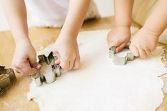Cookie preparation. Children cook a cookie. royalty free stock photos