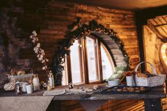 Cookie preparation in an old wooden house in a cozy atmosphere. Cookie preparation in the old wooden house in a cozy atmosphere, on a wooden table stock images