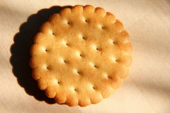 Cookie. Round cracker cookie on wooden board Royalty Free Stock Photo