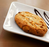 Cookie served on a plate. Dessert enjoyment and celebration concept royalty free stock photo
