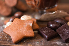 Cookie star with chocolate on wood closeup Royalty Free Stock Photos