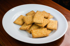 Cookie with sugar on white dish. Mini cookie on white dish Royalty Free Stock Photography