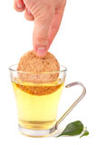 Cookie in the tea Royalty Free Stock Photo