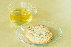 Cookie and tea on desk Stock Image