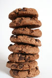 Cookie Tower. A wobbly tower of eight deliciously crumbly chocolate chip cookies against a white background Royalty Free Stock Photography