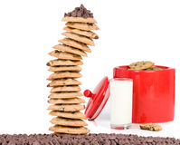 Cookie Tower and Jar. A batch of fresh chocolate chip cookies in a bright red Jar Royalty Free Stock Image