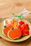 Cookie tray. Fall cookies in the shape of pumpkins and leaves rest on a green plate ready for serving at a party Stock Photography