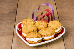 Cookie tray with filled cookies and cutters Stock Images