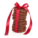 Cookie Treat. Chocolate chip cookie stack tied with a red satin ribbon over white background Stock Photos