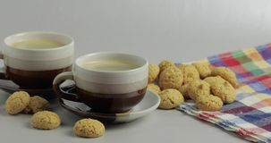 Cookie and two cups of coffee. Kruidnoten, pepernoten, strooigoed. Cookie and two cups of coffee. Kruidnoten, pepernoten, traditional sweets, strooigoed stock footage