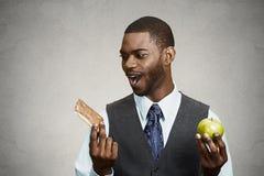 Cookie versus apple, healthy diet choices stock photo
