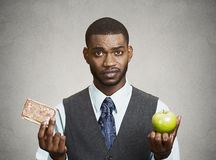 Cookie versus apple, healthy diet choices Royalty Free Stock Images