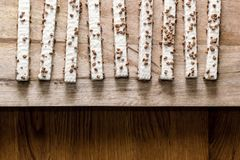 Cookie wafers in glaze on a wooden table royalty free stock image