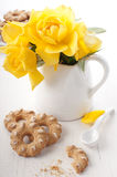 Cookie and yellow rose Stock Images