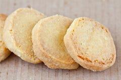 Cookies. Four vanilla cookies on brown Stock Images