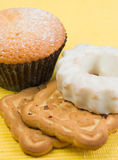 Cookies. Powdered cake, glazed cake and biscuits Royalty Free Stock Images