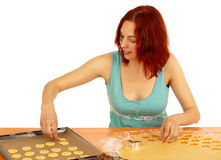 Cookies. A young woman bakes cookies Stock Images