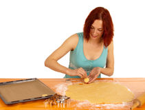 Cookies. A young woman bakes cookies royalty free stock photography