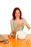 Cookies. A young woman bakes cookies royalty free stock images