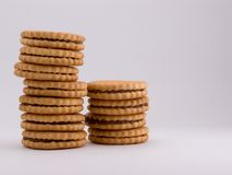Cookies. Two piles of cookies on grey background Royalty Free Stock Images