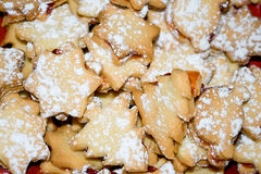 Cookies . Cookies with jam and powdered sugar, by Christmas Stock Photos
