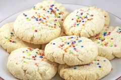 Cookies. Homemade tapioca cookies decorated with colorful balls on a plate royalty free stock photography