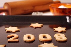 Cookies 2008. 2008 made of Cookies with baking utensils in the background royalty free stock photography