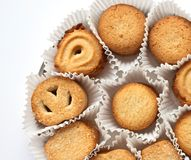 Cookies. In the paper goffered packing (closeup, background Stock Image