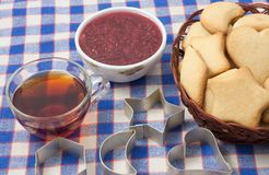 Cookies. With cutters , tea , and raspberry jam stock photo